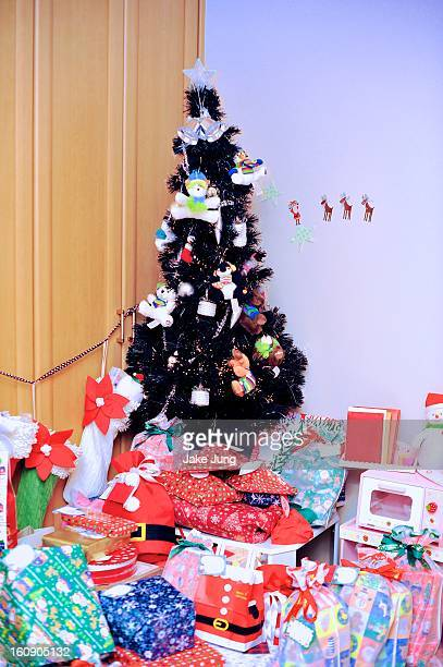Christmas tree surrounded by Christmas presents