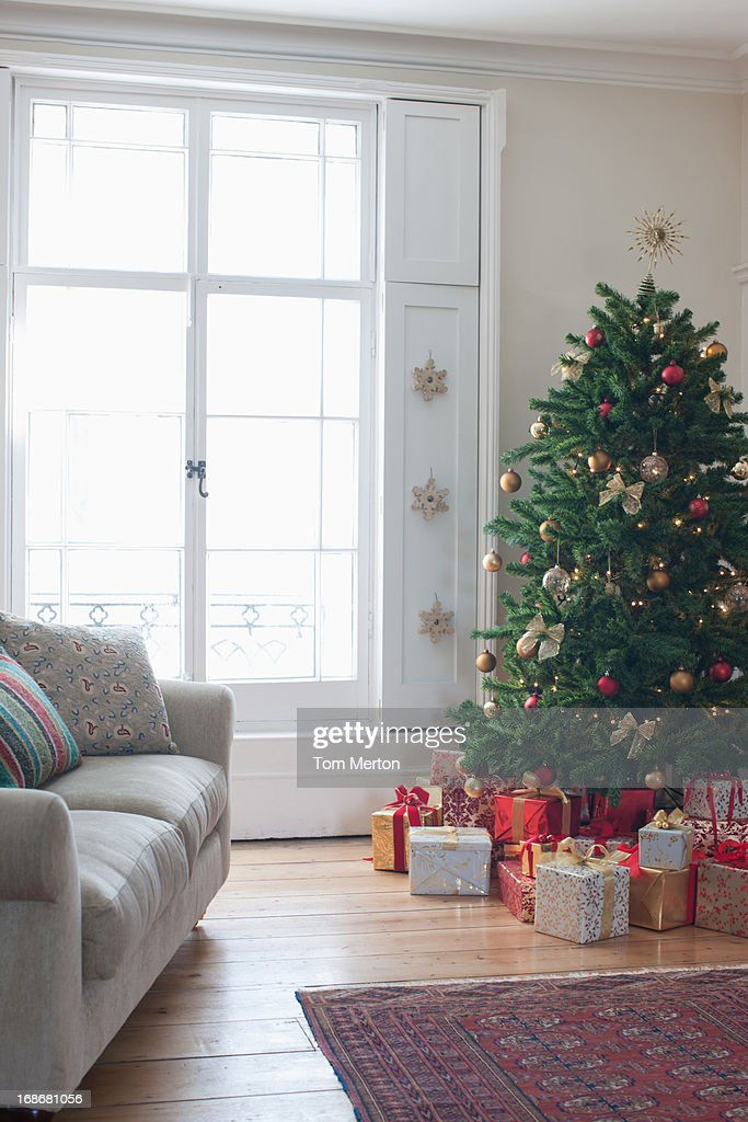 Christmas tree surrounded with gifts : Stock Photo