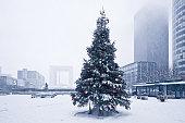 Christmas tree under the snow in La Defense