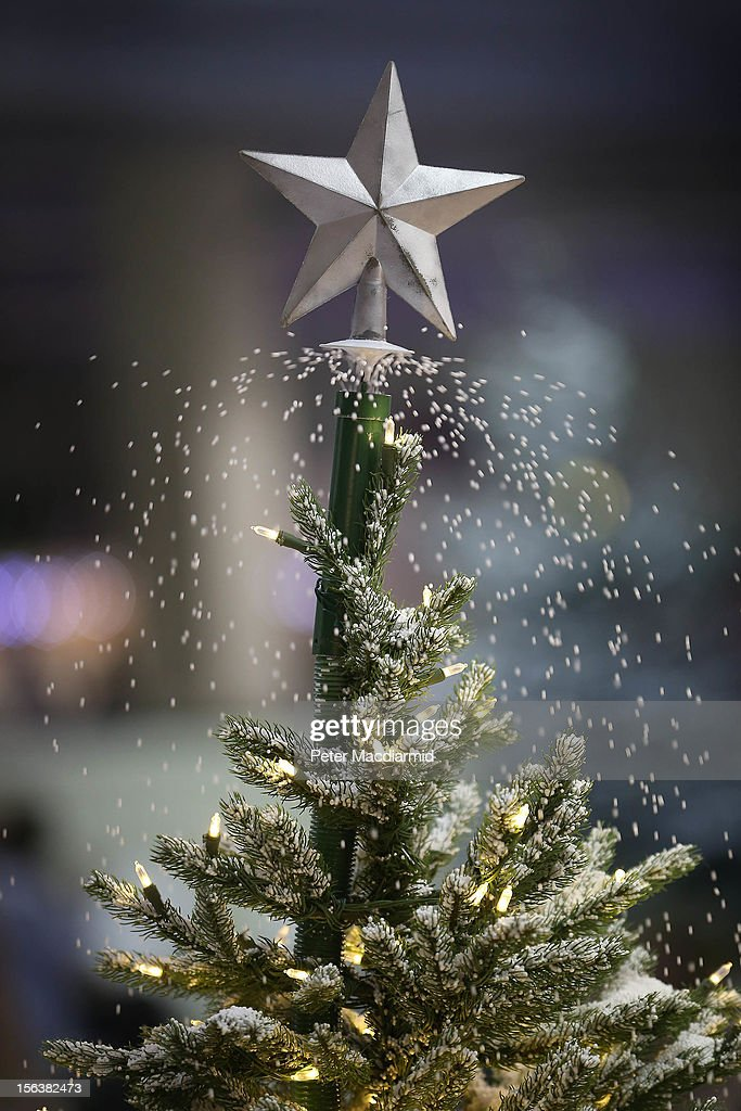 A Christmas tree with it's own supply of snow is demonstrated at The Ideal Home Christmas Show on November 14, 2012 in London, England. Over 400 exhibitors are showcasing a range of gift ideas for Christmas at the Earls Court exhibition centre.