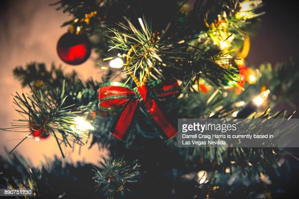 Christmas tree with lights ornaments and bow