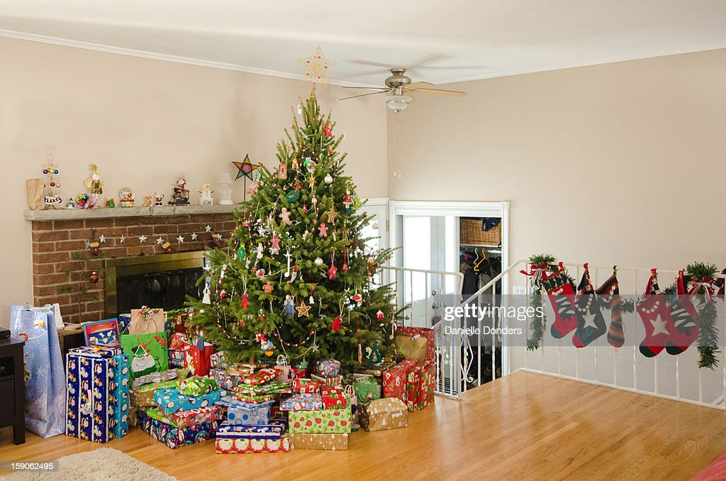 Christmas tree with presents and stockings : Stock Photo