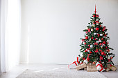 Christmas tree with red decorations new year gifts 2018