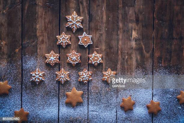 Christmas Tree with Star Cookies on Rustic Background