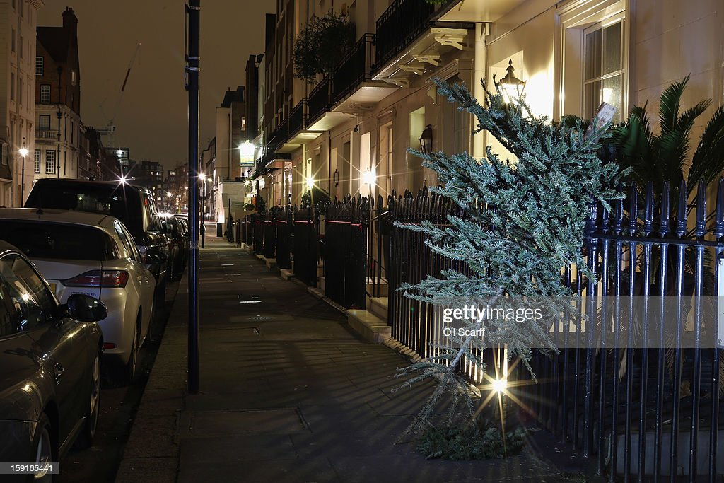 Christmas trees are discarded on the street in the affluent London suburb of Belgravia on January 8, 2013 in London, England. Tradition in the UK is for Christmas decorations to be taken down on the Twelfth Night, which falls on January 5, as it's often regarded as bad luck to leave decorations up after this date.