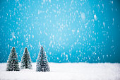 Christmas trees in snow with copy space background