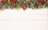 Christmas white wooden background with fir tree. View with copy space. Blue spruce.