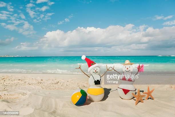 Christmas Winter Snowman Vacationers on Tropical Caribbean Sea Sandy Beach