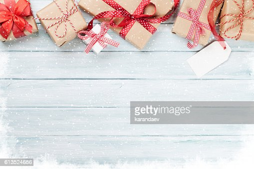 Christmas wooden background with gift boxes and snow : Stock Photo