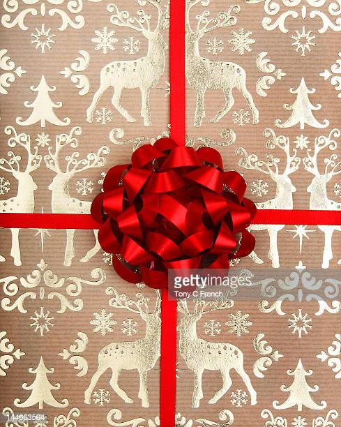 Christmas wrapping paper and bow.