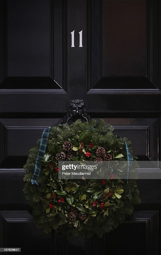 A Christmas wreath decoration hangs on the door of number 11 Downing Street on December 5, 2012 in London, England. Chancellor George Osborne is expected to say that there is no miracle cure for the United Kingdom's financial woes, as the economy struggles for growth, when he delivers his Autumn Statement later in Parliament.