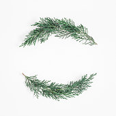 Christmas wreath made of cypress branches on white background. Christmas, winter concept. Flat lay, top view, copy space, square