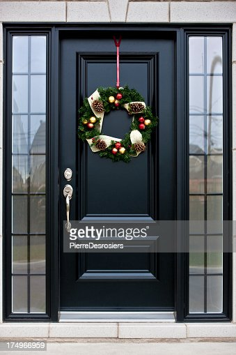 Christmas wreath on black door : Stock Photo
