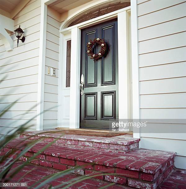 Christmas wreath on front door of house
