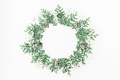 Christmas composition. Wreath made of thuja branches, gypsophila flowers, pine cones on white background. Christmas, winter, new year concept. Flat lay, top view, copy space