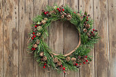 christmas wreath on a rustic wood background