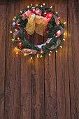 Christmas wreath with christmas lights on wooden door
