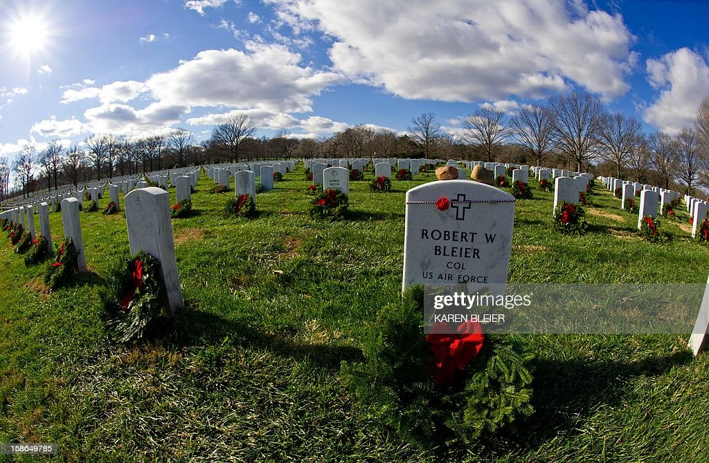 Christmas wreaths adorn graves in Section 60 in Arlington National Cemetery December 22, 2012 in Arlington, Virginia. Each year, evergreen wreaths and red bows are placed at the graves to recognize sacrifices our veterans and their families have made for our country. AFP PHOTO/Karen BLEIER