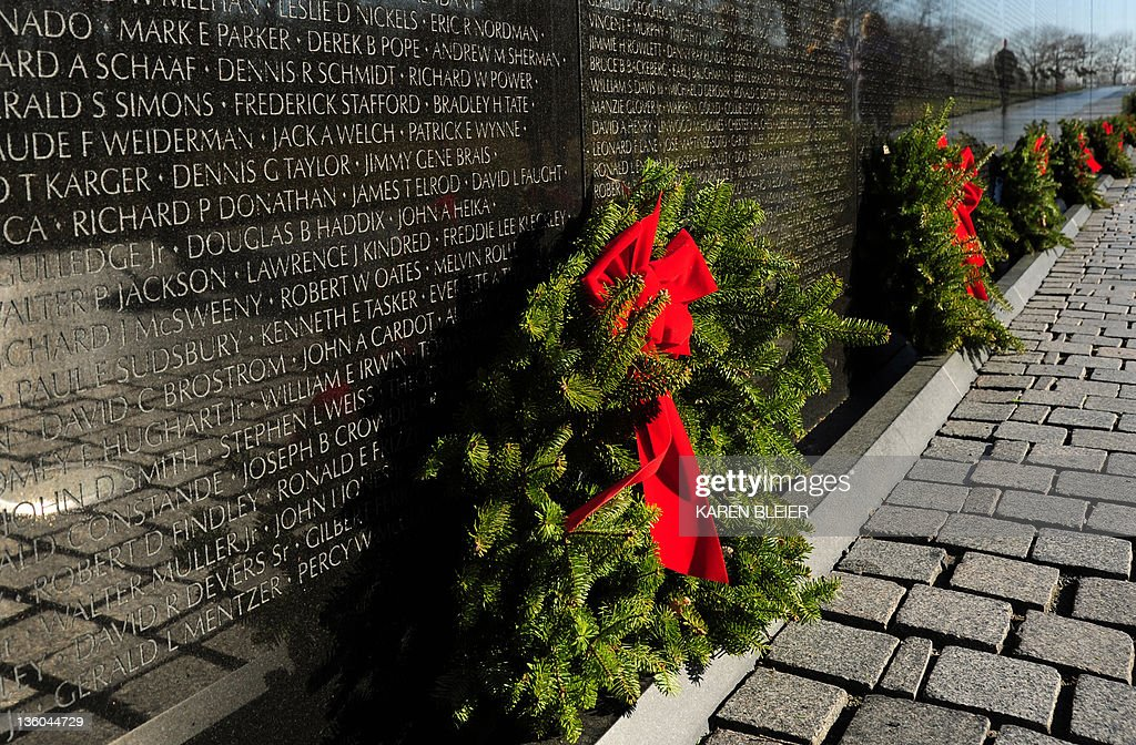 Christmas wreaths adorn the Vietnam Veterans Memorial December 19, 2011 in Washington, DC. The Vietnam Veterans Memorial Fund (VVMF) Honored veterans and active-duty military personnel during its 15th Annual Christmas Tree Ceremony at The Wall. AFP PHOTO/Karen BLEIER