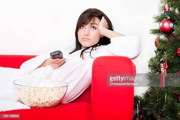 Weihnachten-gelangweilt Frau mit Fernbedienung