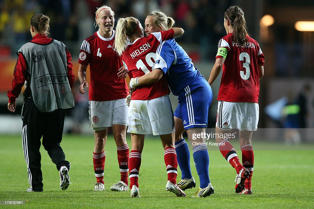 Christna Oerntoft, Mia Brogaard, goalkeeper Stina Petersen and Katrine Soendergaard Pedersen of Denmark celebrate the 1-1 draw after the UEFA Women's EURO 2013 Group A match between Sweden and Denmark at Gamla Ullevi Stadium on July 10, 2013 in Gothenburg, Sweden. The match between Sweden and Denmark ended 1-1.