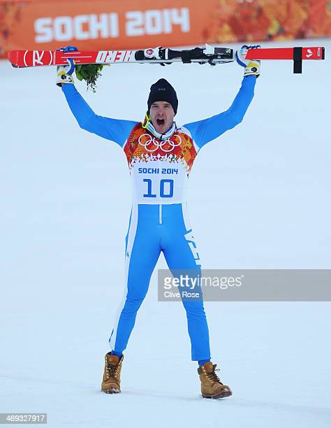 Christof Innerhofer of Italy celebrates after the Alpine Skiing Men's Super Combined Downhill on day 7 of the Sochi 2014 Winter Olympics at Rosa...