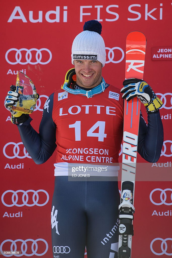 Christof Innerhofer of Italy holds his trophy on the podium after taking second place in the 8th men's super-G event at the FIS Alpine Ski World Cup in Jeongseon county, some 150 kms east of Seoul on February 7, 2016. The FIS Ski Men's World Cup runs from February 6-7 and is the first official test event for the Pyeongchang 2018 Winter Olympics. AFP PHOTO / Ed Jones / AFP / ED JONES