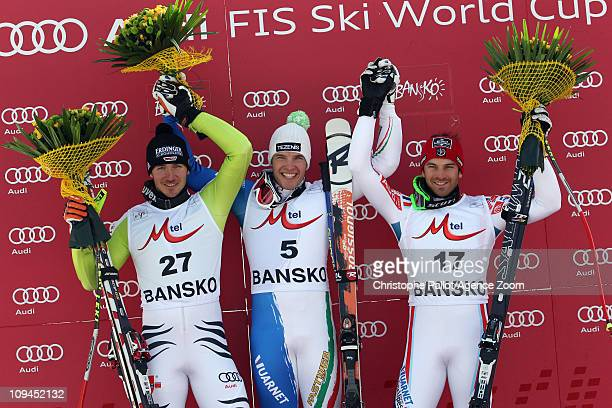 Christof Innerhofer of Italy takes 1st place Felix Neureuther of Germany takes 2nd place Thomas MermillodBlondin of France takes 3rd place during the...