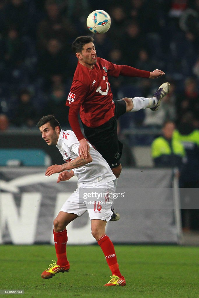 Christofer Schorch of Koeln and Karim Haggui of Hannover go up for a header during the Bundesliga match between Hanover 96 and 1 FC Koeln at AWD...