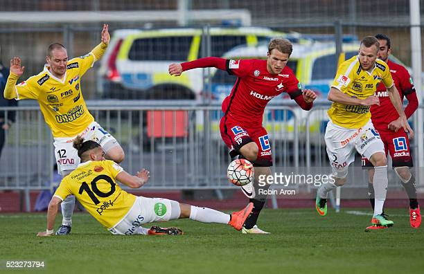 Christoffer Carlsson Alexander Jakobsen and Rasmus Sj��stedt of Falkenberg tries to stop Sebastian Andersson of IFK Norrkoping during the Allsvenskan...
