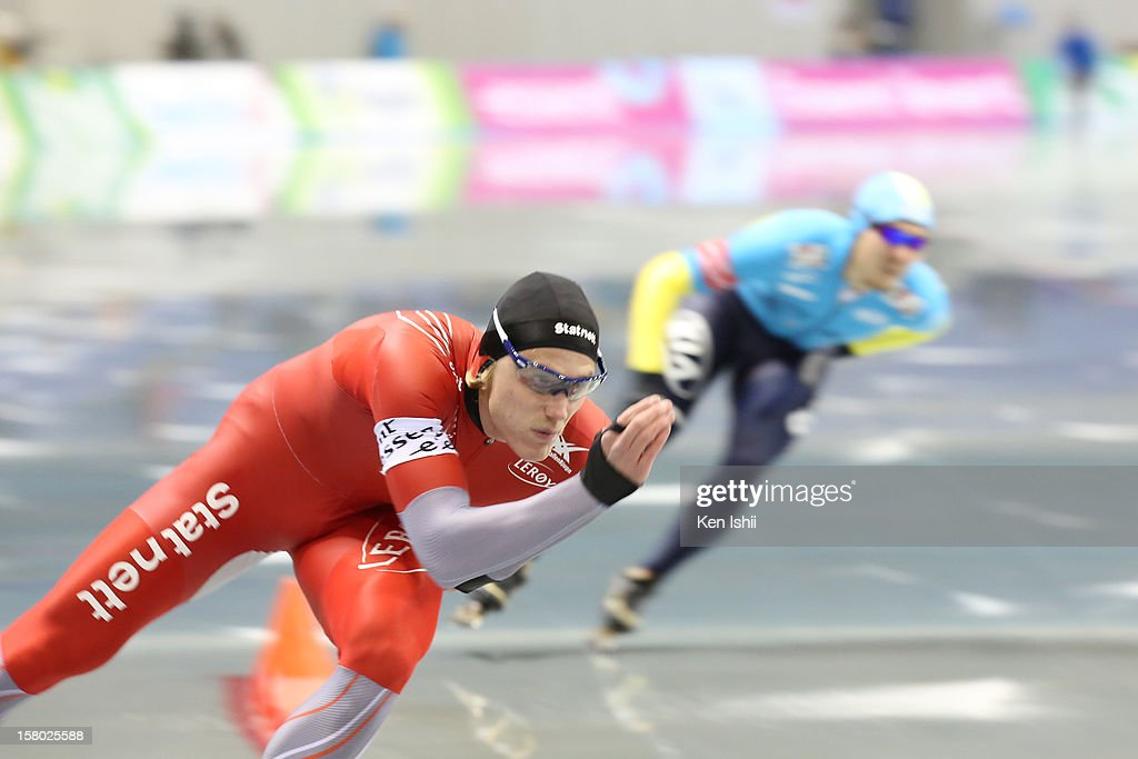 Christoffer Fagerli Rukke of Norway (L) competes with Fyodor Mezentsev of Kazakhstan in the Men's 1,000m during day two of the ISU World Cup Speed Skating at MWave on December 9, 2012 in Nagano, Japan.