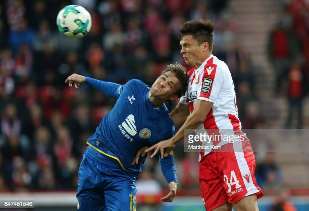 Christoffer Nyman of Braunschweig and Fabian Schoenheim of Berlin jump for a header during the Second Bundesliga match between 1 FC Union Berlin and...