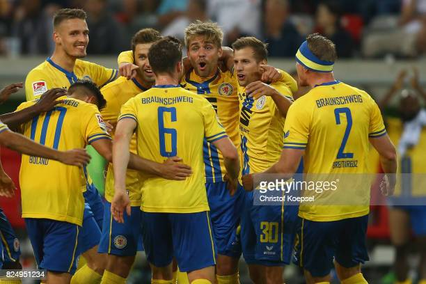 Christoffer Nyman of Braunschweig celebrates the second goal with his team mates during the Second Bundesliga match between Fortuna Duesseldorf and...