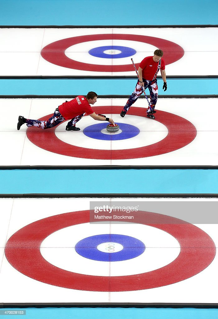 Christoffer Svae of Norway throws the rock and Torger Nergaard sweps while playing Great Britain during the Curling at Ice Cube Curling Center on day 11 of the 2014 Sochi Winter Olympics on February 18, 2014 in Sochi, Russia.