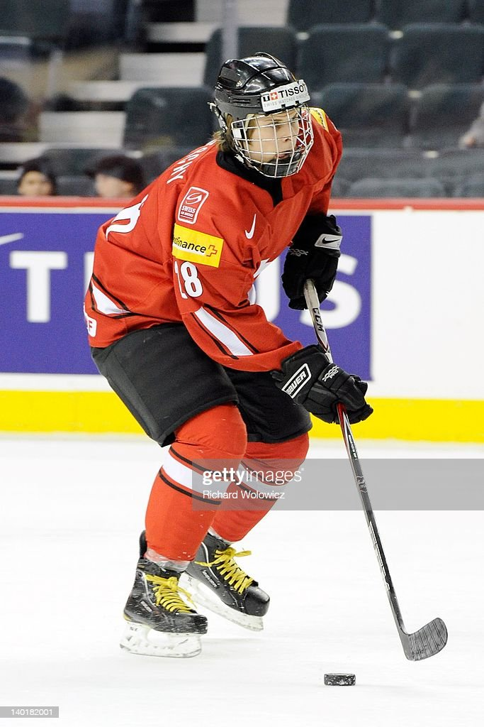 Christoph Bertschy #28 of Team Switzerland skates with the puck during the warm up period prior to facing Team Denmark in their 2012 World Junior Hockey Championship game at the Saddledome on January 2, 2012 in Calgary, Alberta, Canada.