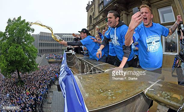 Christoph Hemlein and Pascal Testroet celebrate at the town hall after the Third League match between Arminia Bielefeld and Jahn Regensburg at...