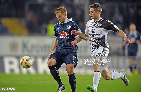 Christoph Hemlein of Bielefeld and Daniel Buballa of St Pauli fight for the ball during the Second Bundesliga match between Arminia Bielefeld and FC...