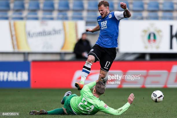 Christoph Hemlein of Bielefeld and Steve Breitkreuz battle for the ball during the Second Bundesliga match between DSC Arminia Bielefeld and FC...