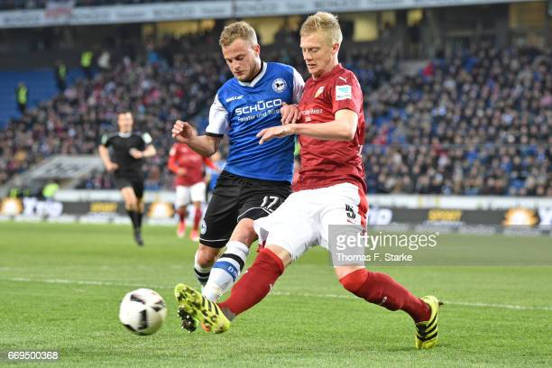 Christoph Hemlein of Bielefeld and Timo Baumgartl of Stuttgart fight for the ball during the Second Bundesliga match between DSC Arminia Bielefeld...