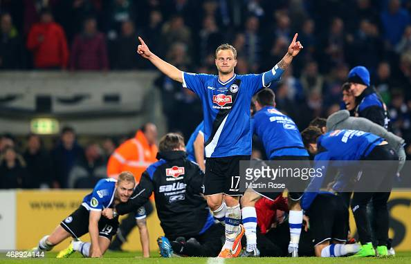 Christoph Hemlein of Bielefeld celebrates after winning the DFB Cup Quarter Final match between Arminia Bielefeld and Borussia Moenchengladbach on...