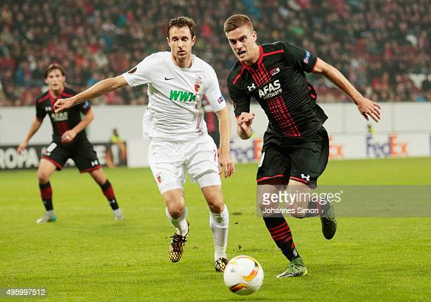 Christoph Janker of Augsburg vies with Markus Henriksen of Alkmaar during the UEFA Europa League group L football match between FC Ausburg and AZ...