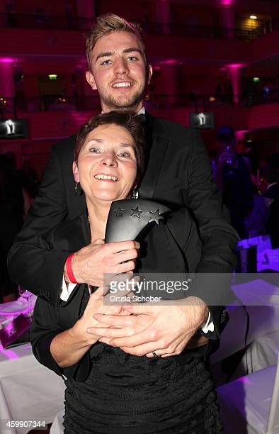 Christoph Kramer and his mother Gabi during the Audi Generation Award 2014 at Hotel Bayerischer Hof on December 3 2014 in Munich Germany