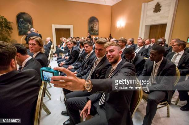 Christoph Kramer and Matthias Ginter ahead a private audience with his team of Borussia Moenchengladbach in the Palace of the Vatican on August 02...