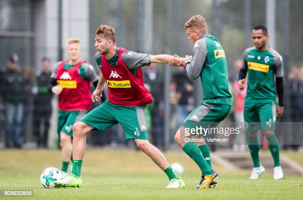 Christoph Kramer and Mickael Cuisance battle for the ball during a training session of Borussia Moenchengladbach at BorussiaPark on July 02 2017 in...