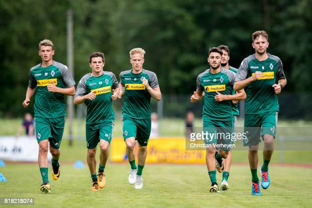 Christoph Kramer Michael Cuisance Vincenzo Grifo Jonas Hofmann Oscar Wend and Tobias Strobl trun during a training session at the Training Camp of...