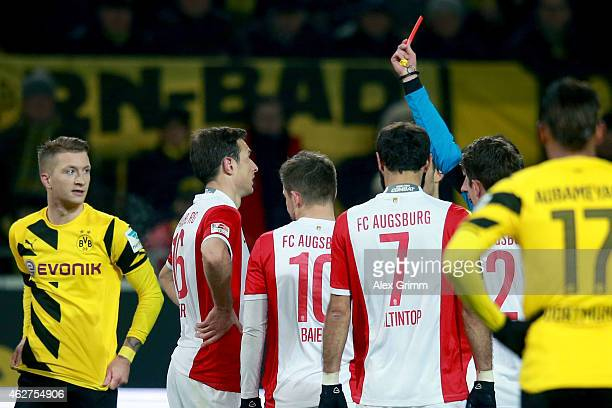 Christoph Kramer of Augsburg receives the Red card from refere Marco Fritz during the Bundesliga match between Borussia Dortmund and FC Augsburg at...