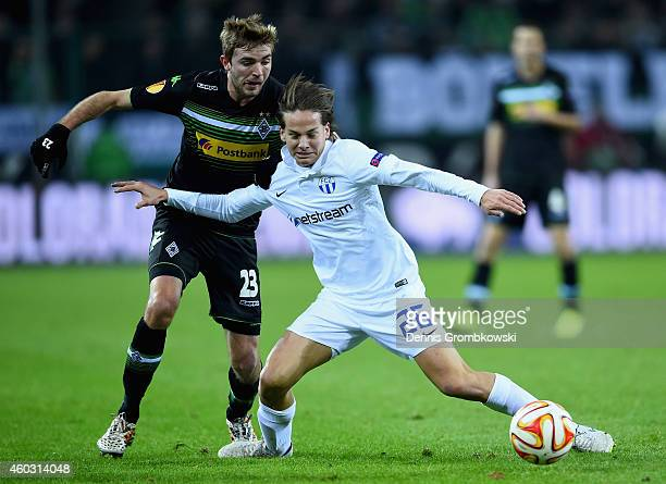 Christoph Kramer of Borussia Moenchengladbach and Cedric Brunner of FC Zurich battle for the ball during the UEFA Europa League group stage match...
