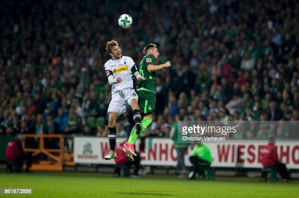 Christoph Kramer of Borussia Moenchengladbach and Izet Hajrovic of Werder Bremen battle for the ball during the Bundesliga match bewtween Werder...