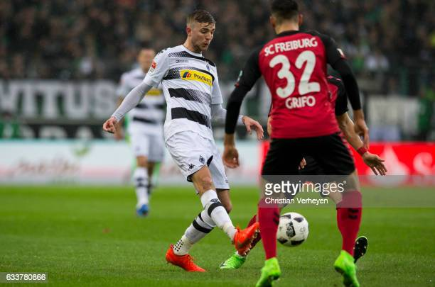 Christoph Kramer of Borussia Moenchengladbach and Vincenzo Grifo of SC Freiburg battle for the ball during the Bundesliga Match between Borussia...