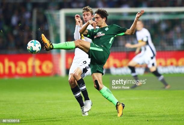 Christoph Kramer of Borussia Moenchengladbach challenges Thomas Delaney of Werder Bremen during the Bundesliga match between SV Werder Bremen and...